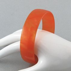 Almost luminous! This terrifically tangerine bangle bracelet is marbled and translucent at the same time. It's a perfect color for fall and just about any time