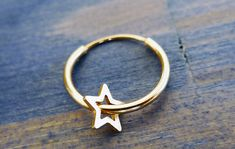 Carry Your Star. 14K Gold Star Hoop Earring or Septum Jewelry.  by #NoaSharonDesigns,