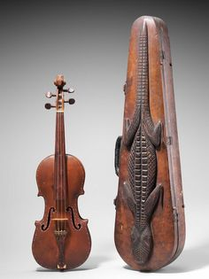 "Folk violin and case, ca. 1936 C. W. Raborn (American) - Materials: Cherry wood - Length: 61 cm - Strings: 4 "" Source: Boston-MFA """