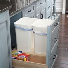 I must have this in my next kitchen. I love how there is an area to store extra trash liners next to the bins.