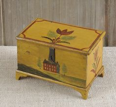 Sold For $38,000                                                          Jonas Weber, Lancaster County, Pennsylvania, ca. 1840, painted pine dresser box, the lid decorated with a red tulip, the sides with tulips and the front with a red brick farm house flanked by trees on a yellow ground, with typical short bracket feet, retaining its original wire loop hinge and tin hasp, 4'' h., 6 1/4'' w., 3 1/2''