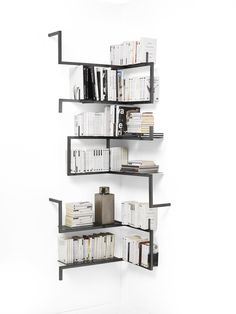 ANTOLOGIA by Mogg / The beauty is in the simple things. And we like the beauty of these simple lines. / Wall metal modular bookshelves elements. Moduli libreria a parete in metallo satinato / STUDIO 14, 2013 / http://www.mogg.it/Prodotti/Storage/ANTOLOGIA/ #Italian #design #storage #bookcase #bookshelves #metal #modular #Antologia #Mogg #unlimiteddesign #Studio14 #libreria #modulare #metallo