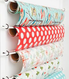 Cup hooks holding the dowels. Great idea for necklace storage.
