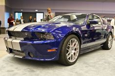 """2014 Shelby Mustang GT at 2013 Los Angeles Auto Show. """" ..takes a standard 2011-2014 Mustang GT and upgrades it to make it look, sound, and drive better."""""""