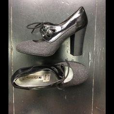 American Eagle heels Good condition, charcoal gray and black classic pumps. Super comfy. American Eagle Shoes Heels