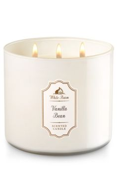 Bath & Body Works White Barn Candle in VANILLA BEAN Madagascar Vanilla Bean, Homemade Marshmallow, Fresh Steamed Milk Candle comes in beautiful colored glass Topped with a flame-extinguishing lid Burns approximately 25 - 45 hours Measures wide x 3 tall