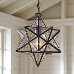 Charlton Pendant | The Charlton's unique star shape and dark steel frame add complexity to the radiance of this pendant light.