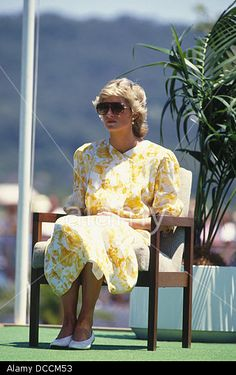 21 March 1983: Charles & Diana attended an open air buffet luncheon, Telegraph Station, Australia. Bright yellow crepe de Chine frock by Jan Vanvelden w/ white abstract motifs, high necked w/ wing collar and pin-tucked front & white waistand.