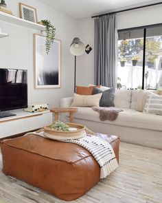Oh hi 👋. It's our FAVE neutral living room of ALL TIME via our girl featuring our favorite over stuffed leather ottoman! Ottoman In Living Room, My Living Room, Relaxing Living Rooms, Brown And Gold Living Room, Living Room Tables, Neutral Living Rooms, Living Room Apartment, Dining Room, Small Living