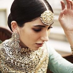 Stunning handcrafted jewels by Kishandas with SabyaSachi bridal gown…