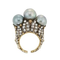 Silver, Gold, Semi-Baroque Gray Cultured Pearl and Diamond Ring, Buccellati   Centering 3 pearls approximately 10.2 mm., 11.6 x 10.6 mm. and 10.4 mm., the gold mounting composed of silver leaves set with rose-cut diamonds, signed Buccellati.