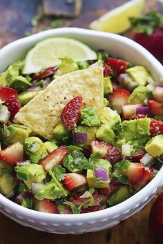 Strawberry Avocado Salsa - Sweet strawberries, bright avocados, red onions, cilantro, and spicy jalapeños come together in a tasty summer salsa you can whip up in minutes!