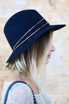 23 Style Lessons We Learned From Miami #refinery29  http://www.refinery29.com/dadeland-mall-miami-street-style#slide9  The metal detail on this navy hat stopped us in our tracks.
