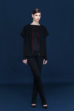 Red zipper vest over the warm black blouse.