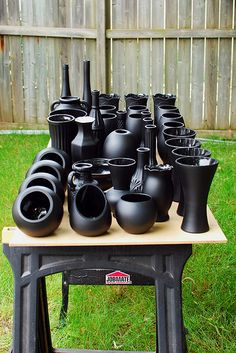 Black Vases: glass and plastic vases spray painted black