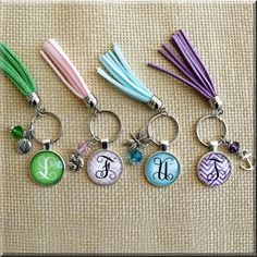 Adorn your keys with this adorable key chain featuring a tassel in your favorite color, coordinating charms, and your initial. Totally customized for you! Diy Tassel, Tassels, Tassel Keychain, Key Rings, Favorite Color, Colorful Backgrounds, Initials, Personalized Items, Key Chains