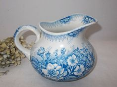 Antique French Ironstone Jug/Pitcher White and Blue Floral Pattern $74 etsy think it's too bright a blue to match mine....need a pitcher to complete my 8 piece set