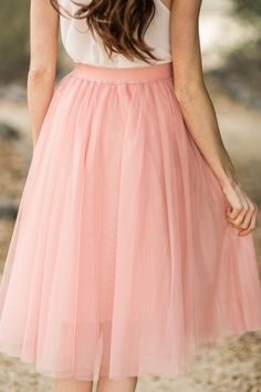 No closet is complete without a tulle midi skirt! This pretty piece has an elastic waist for a better fit, and layers of soft and delicate tulle! Self: 100% Polyester. Contrast: 100% Polyester. Lining