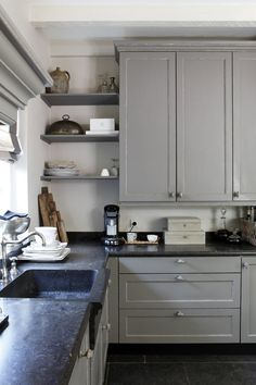 gray kitchen with open shelving--just a touch of open is good…not overwhelming with dust.