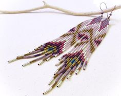 Long earrings seed beads fringes Peacock feather