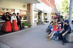 That's me on the left!  :) The Merry Carolers, a Dickensian-style choral group, finds an appreciative audience on South Main Street on a clear and sunny Saturday afternoon in Salinas.
