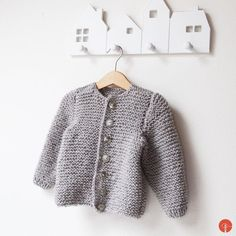 Kids knitted clothes is so adorable. I really like how fast itcan be made. This fluffy cardigan was made for baby which is still waiting in mommy's tummy. A few pics of process… Buttons counting… Still without the buttons. Finally finished hand knitted kids cardigan: Knitting For Kids, Baby Knitting, Knitted Baby Cardigan, Little Boys, Kids Fashion, Men Sweater, Sweaters, Counting, Clothes