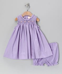 With a smocked and ruffled neckline, embroidered flowers and a sweet babydoll silhouette, this darling dress gets little ones into the springtime spirit. A matching pair of bloomers keeps baby bums blissfully comfy and covered. Toddler Girl Dresses, Little Girl Dresses, Girls Dresses, Smocked Baby Clothes, Smocks, Custom Dresses, Smock Dress, Babydoll Dress, Baby Sewing