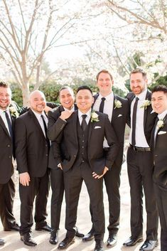 A Dusty Blue and Greenery Italian Inspired Wedding Filled with Timeless Elegance Groom and groomsmen groomsmen matching black suit and tie Groomsmen Attire Black, Groom And Groomsmen Style, Groom Attire, Groomsmen Fashion, Groom Tux, Groom Fashion, Groom Suits, Mens Suits, Black And White Suit