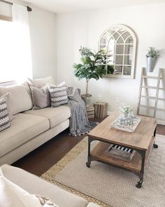 You have to see this #farmhouse living room decor idea with neutral and patterned carpet and wise choice of wooden ornamental details. Love it! #RusticDecor #HomeDecorIdeas