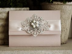 Invitation 1015: Blush Pearl, Cream Smooth, Pinyon Script, High Tower, Blush Ribbon, Brooch/Buckle T, Metal Filigree F6 - Silver - I'm obsessed with these invites.