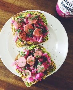 Breakfast this morning is 2 pieces of sprouted wheat toast topped with avocado, hot sauce, picked onions, pickled radishes + fresh dill, alongside a @kevitadrinks #kombucha.