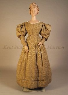 Pale green silk brocade dress, dated 1828-1832, American, Kent State University Museum collection: 1983.001.0052 ab. Also displayed with a bonnet and shawl.