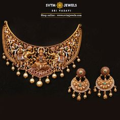 Be more attractive by wearing this traditional gold short Choker and its matching earrings studded with Cubic Zircone ,Ruby Stones, Swarovski pearls and distinct Lakshmi designs on the choker. Gold Temple Jewellery, Gold Jewelry, Diamond Jewellery, Bridal Jewelry, Antique Jewellery Designs, Antique Jewelry, Jewelry Design, Choker Necklace Online, Indian Jewelry