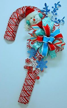 This wreath is made and ready ti ship!! Order yours today! This candy cane door hanger is 28 x 13 in size great for your front door This candy cane form is wrapped with colorful red and white peppermint stripe ribbon. I added a large bow attached to the front with colorful