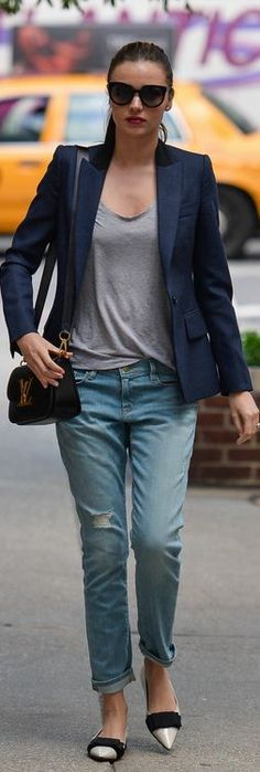 Miranda Kerr: Jacket – Stella Mccartney  Shirt – Isabel Marant Etoile Tank Top  Purse – Louis Vuitton  Sunglasses – Marc Jacobs  Jeans – Frame Denim  Shoes – Miu Miu
