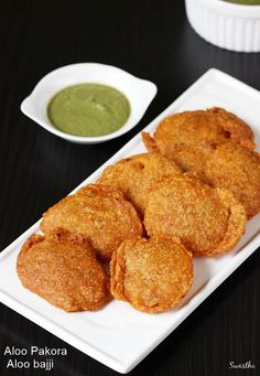 Aloo parkora recipe – Also known as aloo bajji, these are another tea time snack mostly sold in tiffin centres and street stalls. Though not very popular, these are made in many homes especially during the monsoon to accompany their masala chai or coffee. To make aloo pakora, sliced potatoes are dunked in chickpea batter …