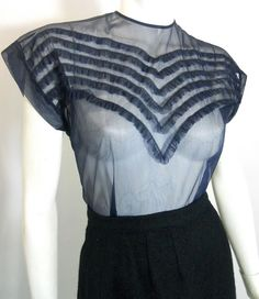 Navy blue sheer nylon 50s blouse with ruffled front, buttons up back