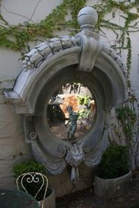 French grey mirror. I love the frame but would not have a mirror in the garden as birds might fly into it.