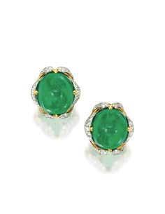 Pair of Platinum, 18 Karat Gold, Emerald and Diamond Earclips, Verdura | Centered by two cabochon emeralds together weighing approximately 64.00 carats, framed by gold and diamond arches, set with numerous round diamonds weighing 4.62 carats, signed Verdura. | Sotheby's