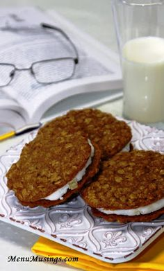 Chewy oatmeal sandwich cookies with candied ginger creme filling. Step-by-step photo recipe tutorial to making these gorgeous cookies!