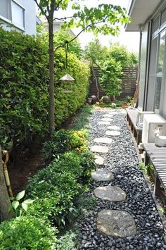 Solution for that small side yard path crushed limestone and stepping stones.