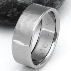 When life gives you lemons you make lemonade. This Titanium ring has transformed its hammered surface into a multi-faceted festival of style. Shown here 7mm wide, this flat profile ring makes a great partner if you are hard on rings. It can shake off tough treatment and still look good, better even. We suggest ordering it with a matte finish. Handcrafted here in the USA.