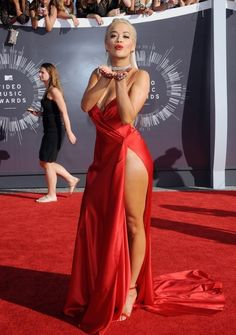 Rita Ora graced the red carpet in a red silk charmeuse Donna Karan gown with a thigh high slit that reminded us of Marilyn Monroe.  The gown looked like it was being held together with a one simple stitch. This is one of our best dresses for the 2014 VMAs.  http://famehorsewire.com/red-carpet/2014-vmas-red-carpet-wore-best-picks/759/