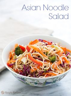 Asian Noodle Salad with Ginger Garlic Sesame Dressing on SimplyRecipes.com Lots of colorful veggies tossed in too! (I added toasted sesame and almonds and i used more pasta)