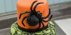 Make your own scary spider cake with giant spider layon from Cakes.com