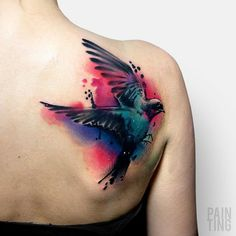 Colorful swllow back tattoo - 100 Lovely Swallow Tattoos