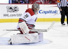 Carolina Hurricanes goalie Cam Ward (30) watches the puck during the first period of an NHL hockey game against the Washington Capitals, Monday, Jan. 23, 2017, in Washington. (AP Photo/Nick Wass)