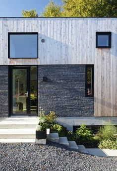 Cool combination of materials and a beautiful meeting between nature and architecture
