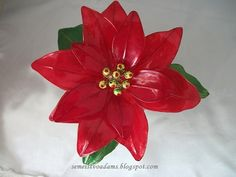 Wire poinsettia with nail polish by semeistvoadams.blogspot.com