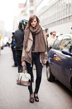Thick blanket scarf layered over a leather moto jacket and skinny jeans